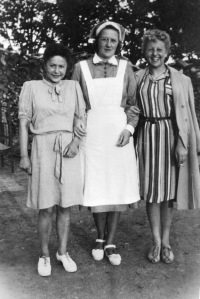 Eighteen days after Rosie's departure from Hamburg, standing with former German prisoner Ilse Schmidt and nurse Huvud Lottoo
