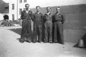 Workers at the reception center in Sweden (former prisoners in background)