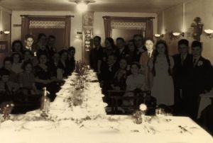Photo of a family gathering in 1939, showing the only two survivors