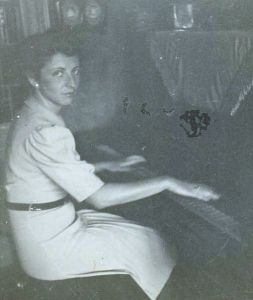 Rosie playing piano at Ernst's place, 1941