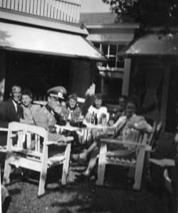 Rosie on a café terrace with a German officer